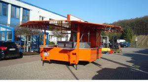 gebrauchter-ausschankwagen-kuehlhaus-mitteltheke-orange