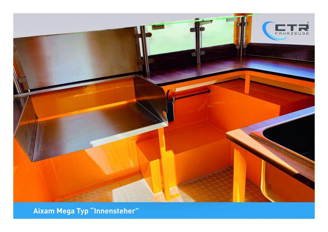 Aixam_Mega_Innensteher_orange_3