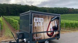 Der Weinwagen.
